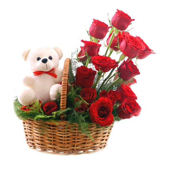 Cute Teddy sitting in a Red Roses Basket