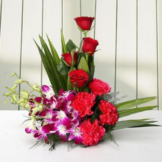 Cute Arrangement Carnations N Orchids flowers delivery in Cute Arrangement Carnations N Orchids