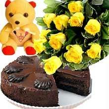 A bunch of 12 Roses with 1/2 kg Chocolate Cake and a cute Teddy flowers delivery in A bunch of 12 Roses with 1/2 kg Chocolate Cake and a cute Teddy