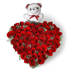 Heart Shape Arrangement of 50 Red roses with small cute teddy flowers delivery in Heart Shape Arrangement of 50 Red roses with small cute teddy