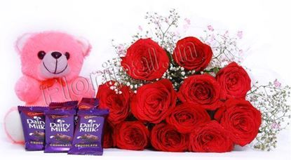 "Bunch of 12 red roses and small dairy milk chocolates with 6"" inches small Teddy"