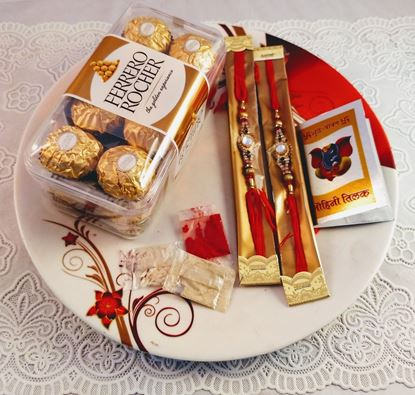 2 Rakhi with Roli Chawal and 16 Pc Box of Ferraro Rocher