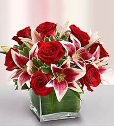 Hand-crafted arrangement of romantic roses and lilies in Glass Cube